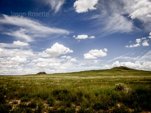 High desert landscape with two ancient volcano peaks, seen from Petroglyph monument New Mexico