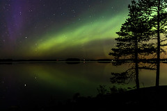 Northern lights over lake Kallavesi in Finland