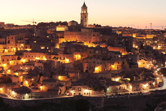 """Image by Bruno Tartaglione (184060075@N02) and image name THE MAGIC OF THE SASSI, MATERA photo  about Matera ancient town, the """"Sassi"""". The Sassi originated in a prehistoric troglodyte settlement. They are are habitations dug into the calcareous rock itself, which is characteristic of Basilicata and Apulia. Many of them are really little more than caverns, and in some parts of the Sassi a"""