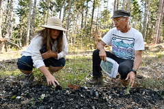 Kelpie Wilson and Ken Carloni with biochar pile