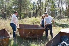 Amy Fischer, Kelpie Wilson and Ken Carloni move an Oregon Kiln
