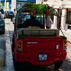 And why not a flourished  Lisbon Piaggio TukTuk?