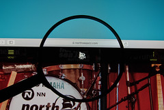 North Sea Jazz Festival website on a computer screen with a magnifying glass