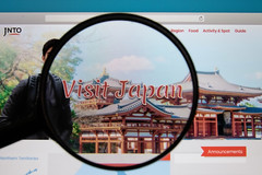 Visit Japan website on a computer screen with a magnifying glass