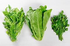 Fresh arugula, romaine salad and parsley. Top view