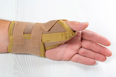 Bandage on the wrist of a man with a bruised hand
