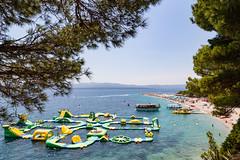 Bouncy castle in the Adriatic Sea of Bol, Croatia