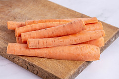 Fresh Domestic Carrots sliced on the wooden board