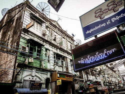 Signs and Wires on a Side Street in Downtown Yangon, Myanmar