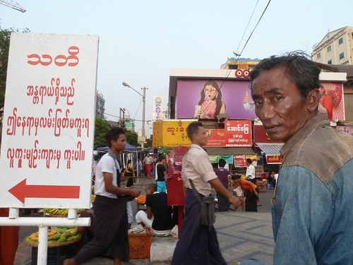 Man stops to look at the camera on busy intersection in Yangon, Myanmar