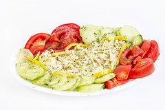 Traditional Salad with sliced Cabbage Tomato Cucumber and Paprika