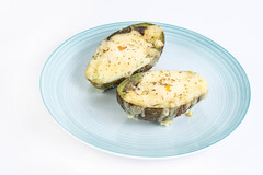 Baked Avocado with eggs and grated cheese
