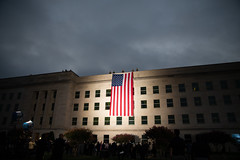 An American flag is displayed over the west wall of the Pentagon at the National 9/11 Pentagon Memorial