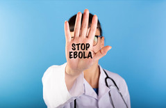 Text Stop Ebola in the palm of doctors hand