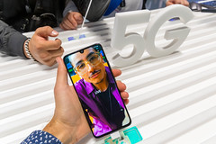 Man holds Samsung Galaxy A90 5G smartphone with Live mode in his hand
