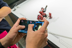 Man controls the Komsa GJS robot via smartphone