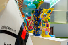 Berlin souvenirs: colorful Buddy Bears from behind with stamp motive