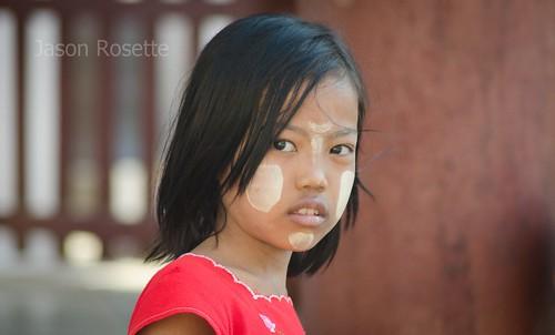 Burmese girl with red shirt and Thanika cheeks at Bagan