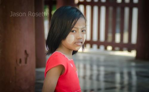 Burmese girl with red shirt and Thanika cheeks at Bagan (wider)