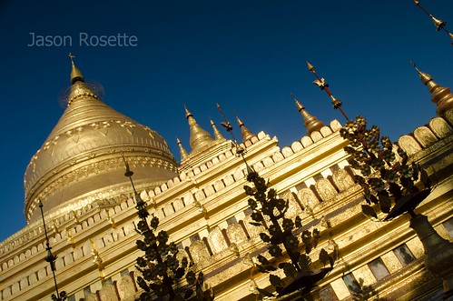 Golden temple in Bagan, Myanmar, with metal spires in foreground