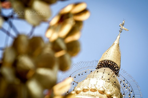 Golden flower ornaments in foreground, Golden Bagan temple in background (#1)