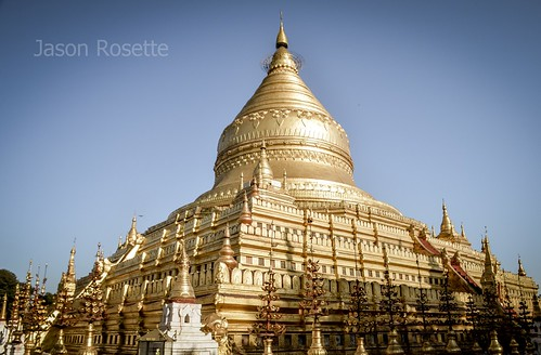 Golden temple in Bagan, Myanmar, with metal spires in foreground (Wide View)