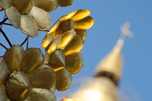 Golden flower ornaments in foreground, Golden Bagan temple in background (#2)