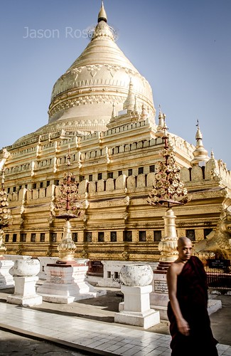 Golden temple in Bagan with Monk in Foreground