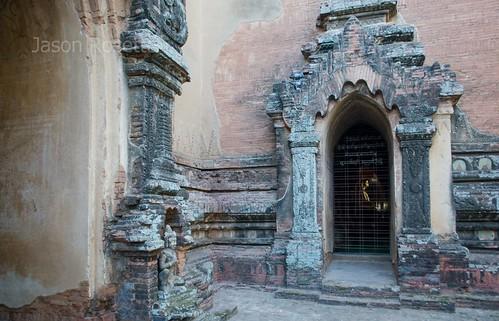Brick arched doorway in temple courtyar, Bagan, Myanmar
