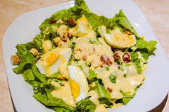 A healthy egg salad plate with creamy sauce