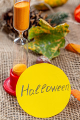 The concept of the imminent onset of Halloween. Hourglass and Halloween tag