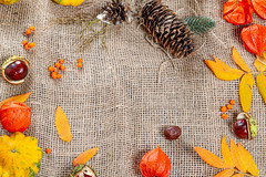 Autumn frame on burlap with free space. Concept Halloween, thanksgiving, autumn holidays