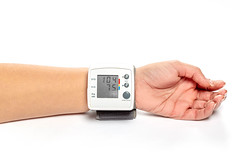 Blood pressure and pulse tonometer on the patient's wrist