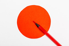 Red circle and red pencil-the concept of an important decision, attention