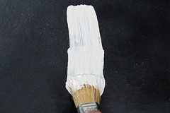 Brush in white paint large background. The concept of repair