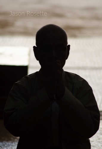 Silhouette of a Man Praying at a Temple in Bagan, Burma (#1)