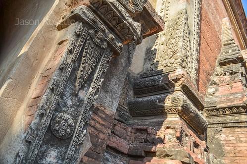 Detail of decorative concrete surface on older brick temple, Bagan, Myanmar