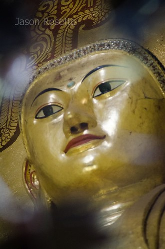 Face of Burmese Buddha Statue in Shady Hall