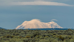 Image by hut640 (184000041@N08) and image name Top of Rainier photo  about from 112 miles, morning light with overcast skies. Tamron 150-600mm x1.3 crop on sensor = 1170mm eq.
