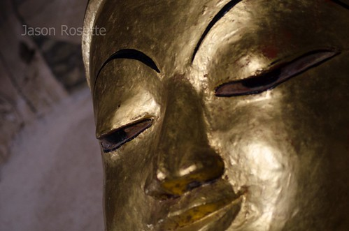 Blissful eyes of a Golden Buddha figure in Bagan Temple, Myanmar