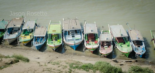 Row of Boats on bank of the Irriwaddy River, Burma (Medium View)