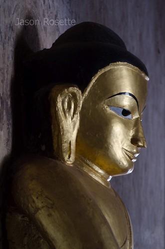Golden Buddha Statue in Dim Hallwayy, Bagan Temple