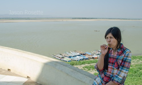 Burmese Woman With Lollipop by the Irriwaddy River, Myanmar