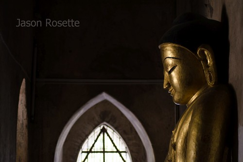 Golden Buddha in Dim Hallway of Bagan, Burma Temple