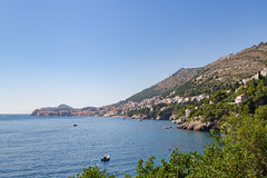 A distant view of Divovici Beach and the Old Town of Dubrovnik, Croatia