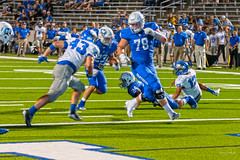 Image by Stephen J Pollard (Loud Music Lover of Nature) (stephen_pollard) and image name Midlothian vs Joshua photo  about Blake is about to give one last block to open the end zone for number 24 for a touchdown. Blake está por dar un bloque que abrirá la zona de anotación para otro ensayo.