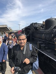 Posing next to the steam locomotive after the ride