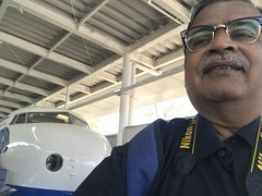I was struggling to take a selfie against Japan's first Shinkansen bullet train