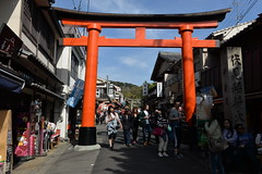 An vermilion torii gate greets you long before you get to the Fushimi Inari shrine