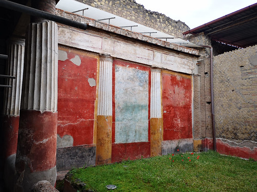 The Viridarium, an enclosed garden with walls decorated with red and black panels containing garden scenes with images of plants and birds along the lower frieze, Oplontis (also known as Villa Poppaea and Oplontis Villa A), Italy